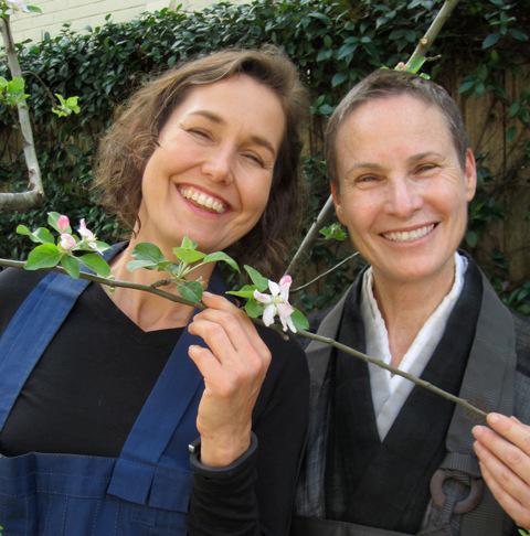Shinji Mary Carol Edwards & Abbot Gaelyn Godwin with the blooming apple tree