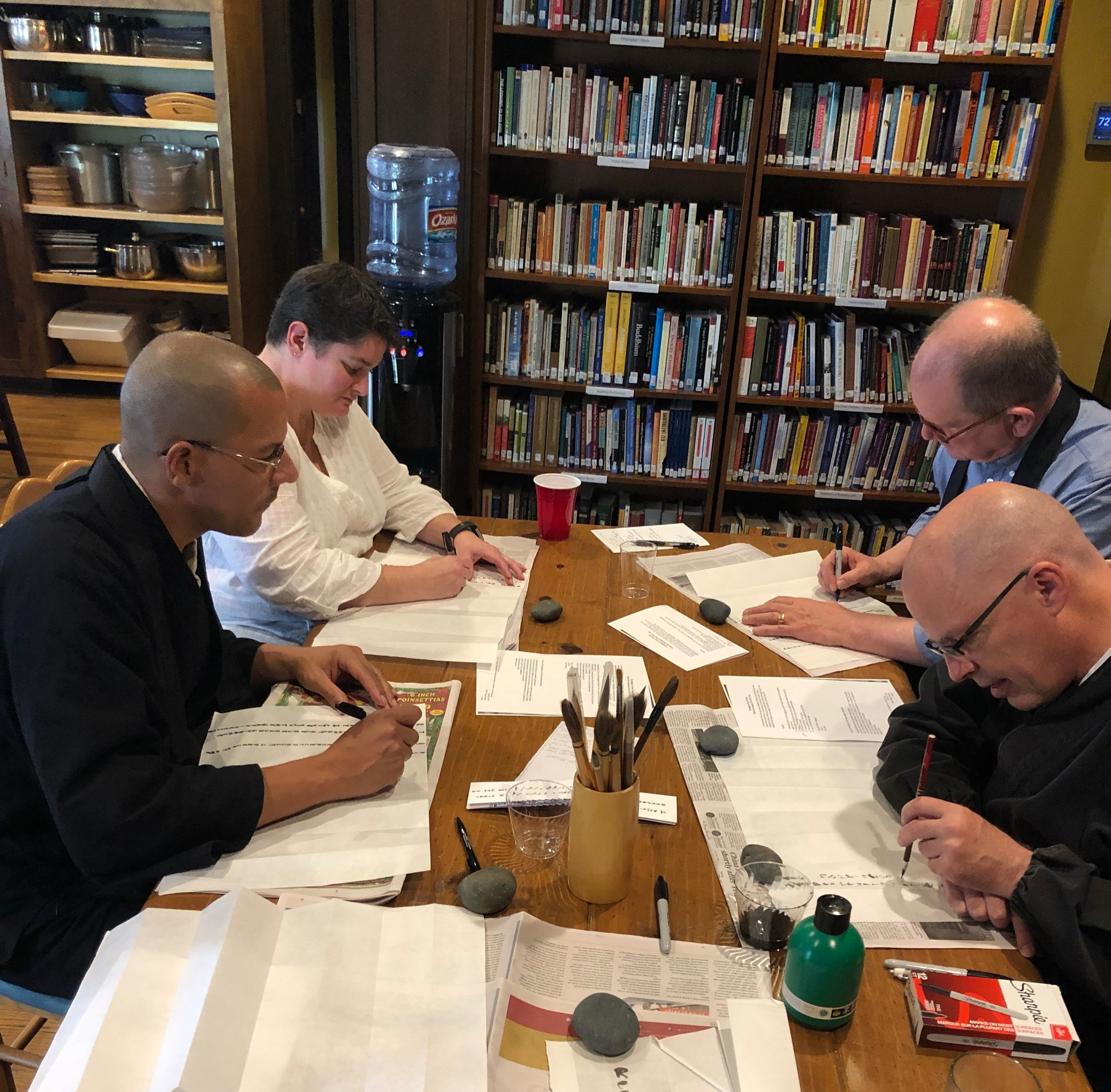 Royce, Vicki, Tim, and Glen working on documents for New Year's greetings.