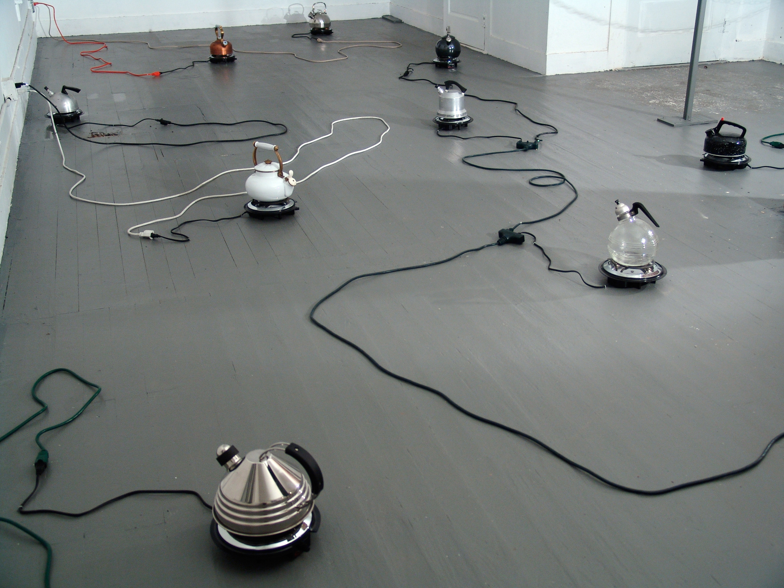 Conductor,   2004  whistling kettles, hot plates, electrical chords, water, steam  Installed at Project Row Houses, TX