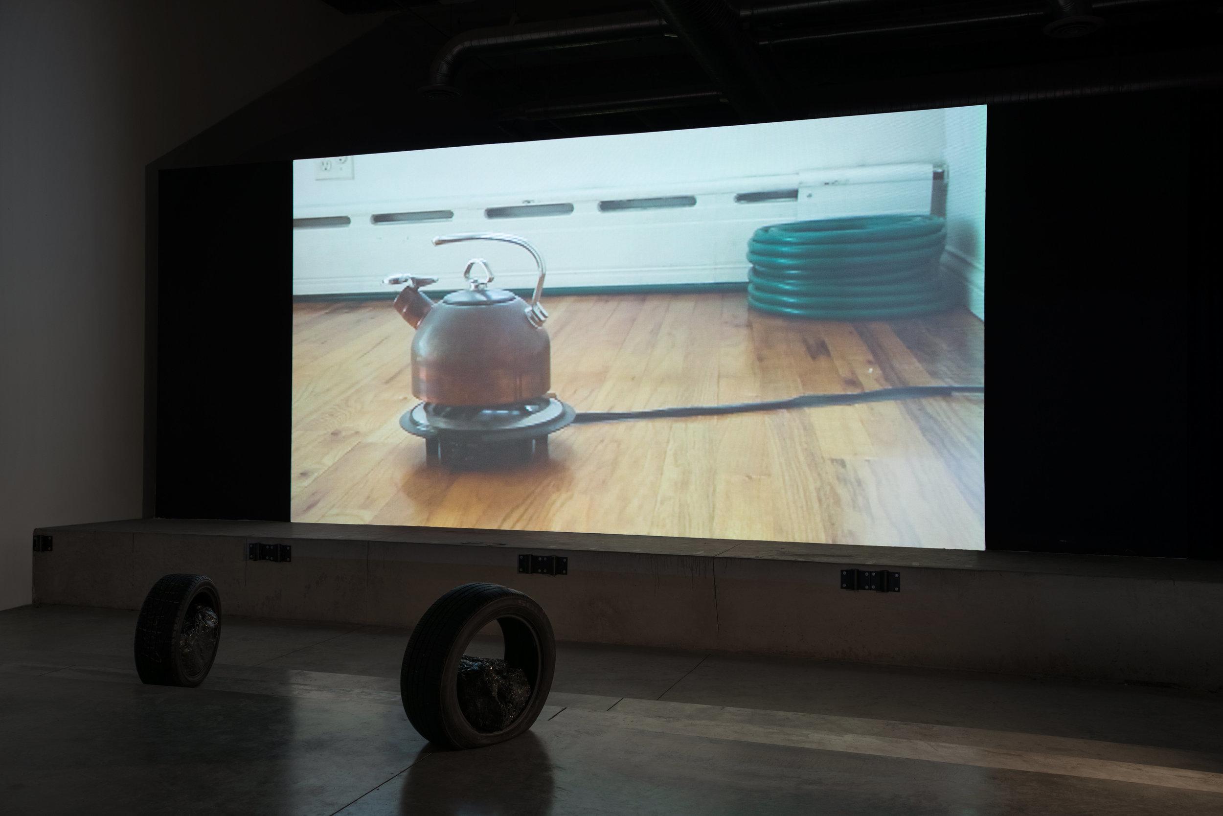 Terrestrial  , 2013  single channel video, dog door, tires, anthracite