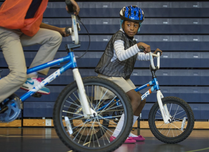 D.C. KIDS LEARN TO RIDE BICYCLES IN SCHOOL (article)