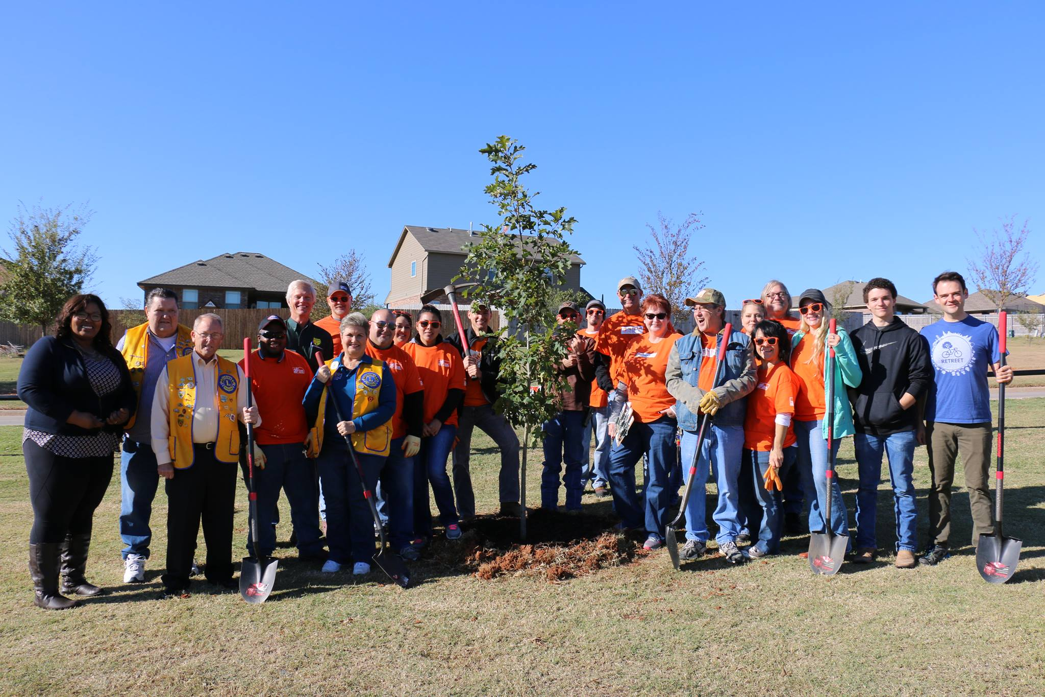 TEAM DEPOT POSES WITH LOCAL MEMBERS OF LIONS CLUB INTERNATIONAL, OKLAHOMA FORESTRY SERVICES, AND RETREET STAFF