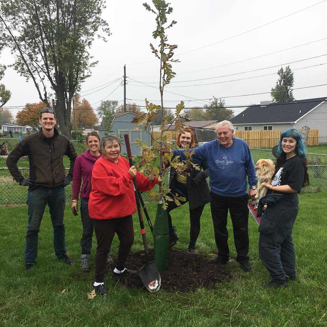 A HAPPY FAMILY IN KOKOMO WITH THEIR NEW TREE