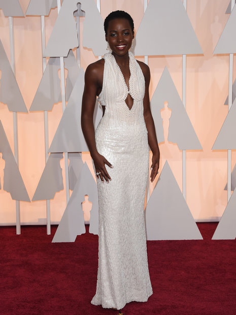 Lupita Nyong'o in Calvin Klein Collection HOLLYWOOD, CA - FEBRUARY 22: Actress Lupita Nyong'o attends the 87th Annual Academy Awards(Photo by Jason Merritt/Getty Images)