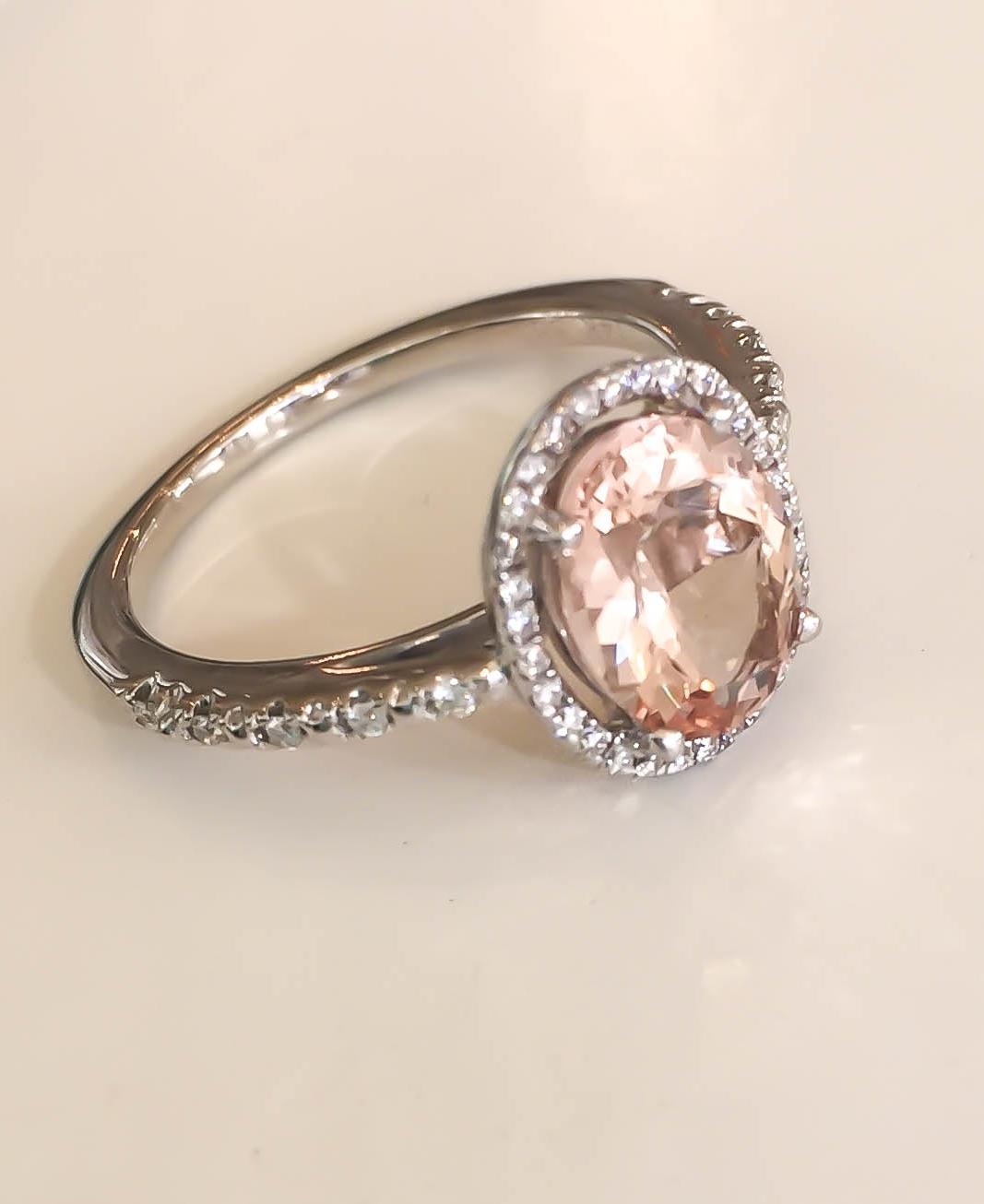Oval morganite halo diamond ring
