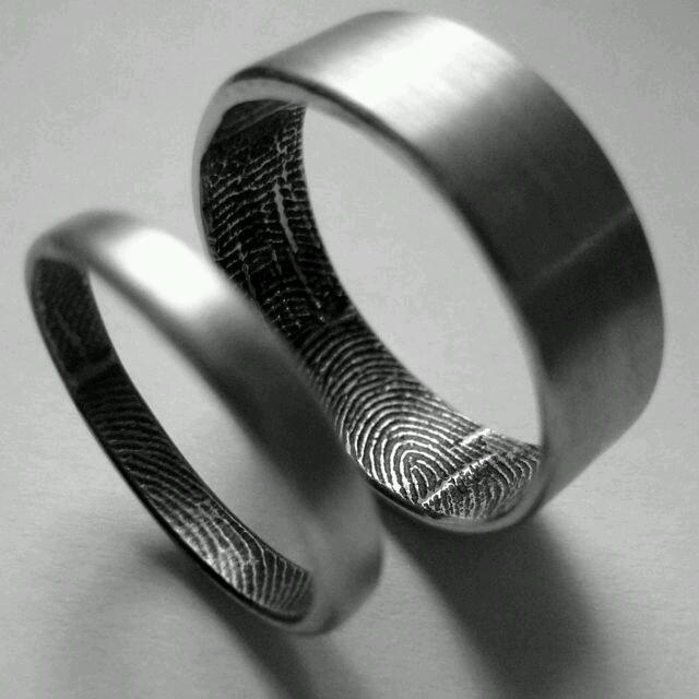 Titanium rings with custom Fingerprint interior option