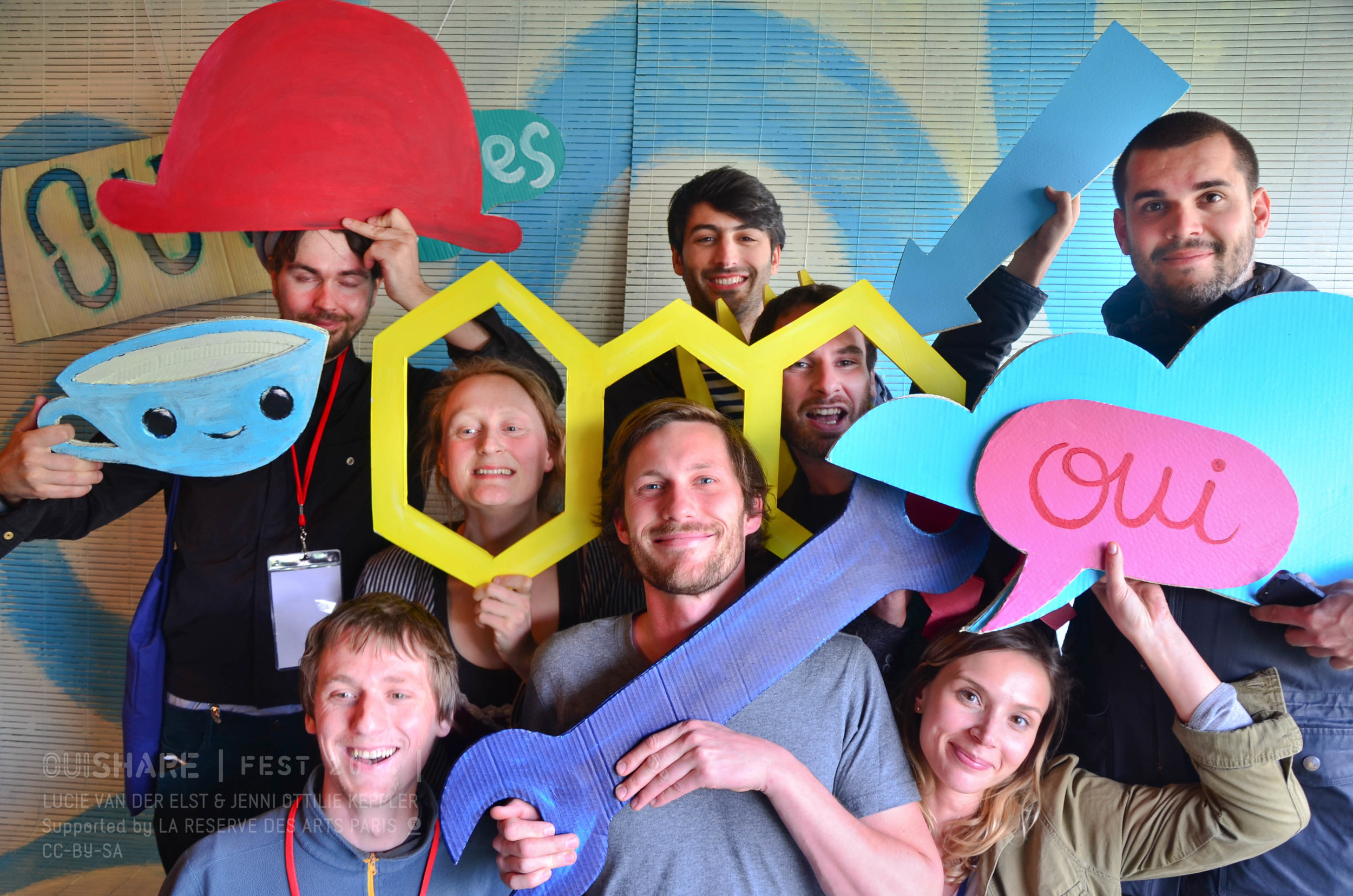 The Open Source Hardware Crew gathering for a picture in the OUIShapes Photo Booth
