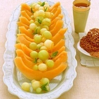 A tray of delicious fruit boats.jpg