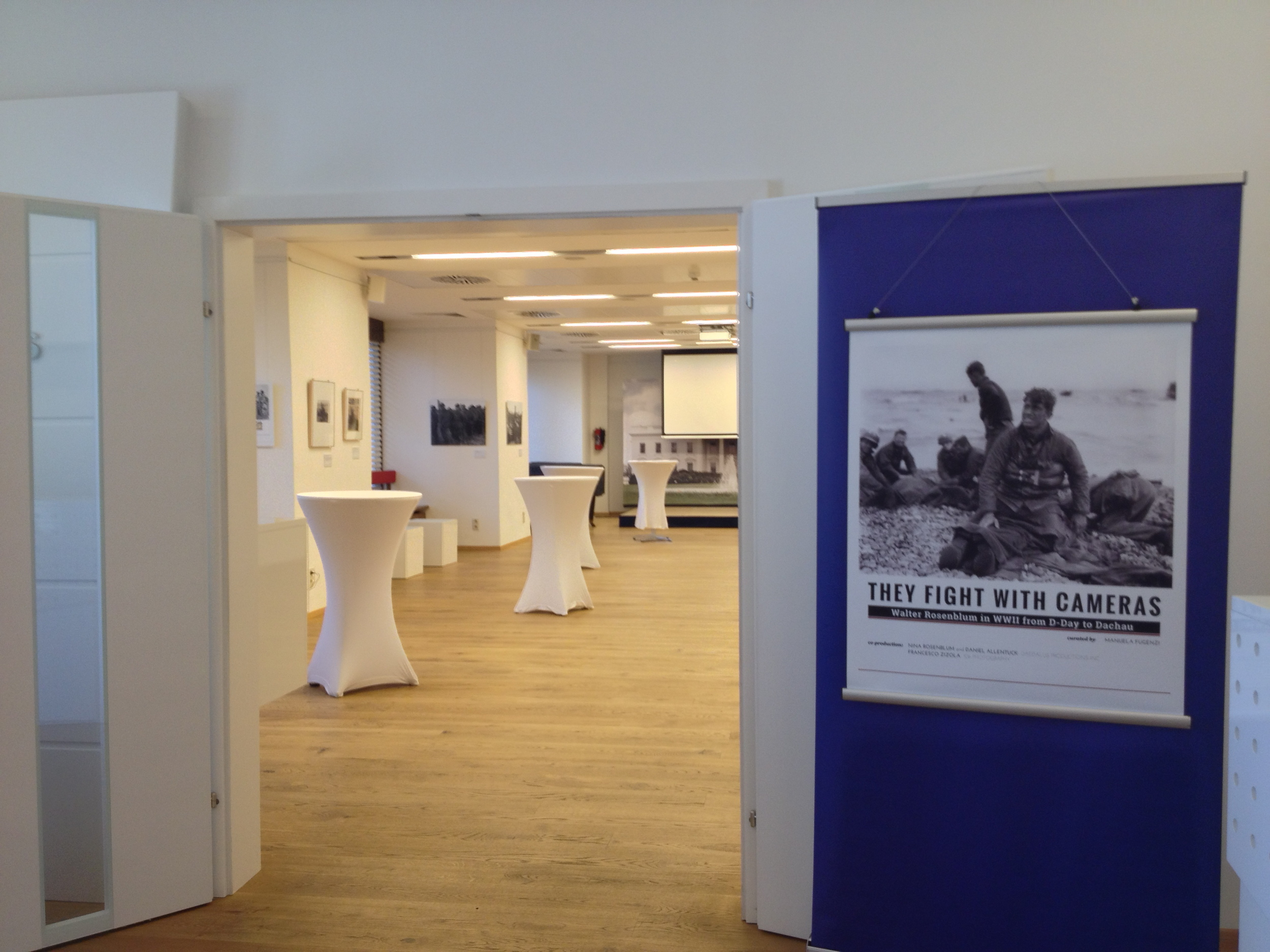 """They Fight With Cameras: Walter Rosenblum in WWII From D-Day to Dachau"" Exhibition Banner, Amerika Hau"