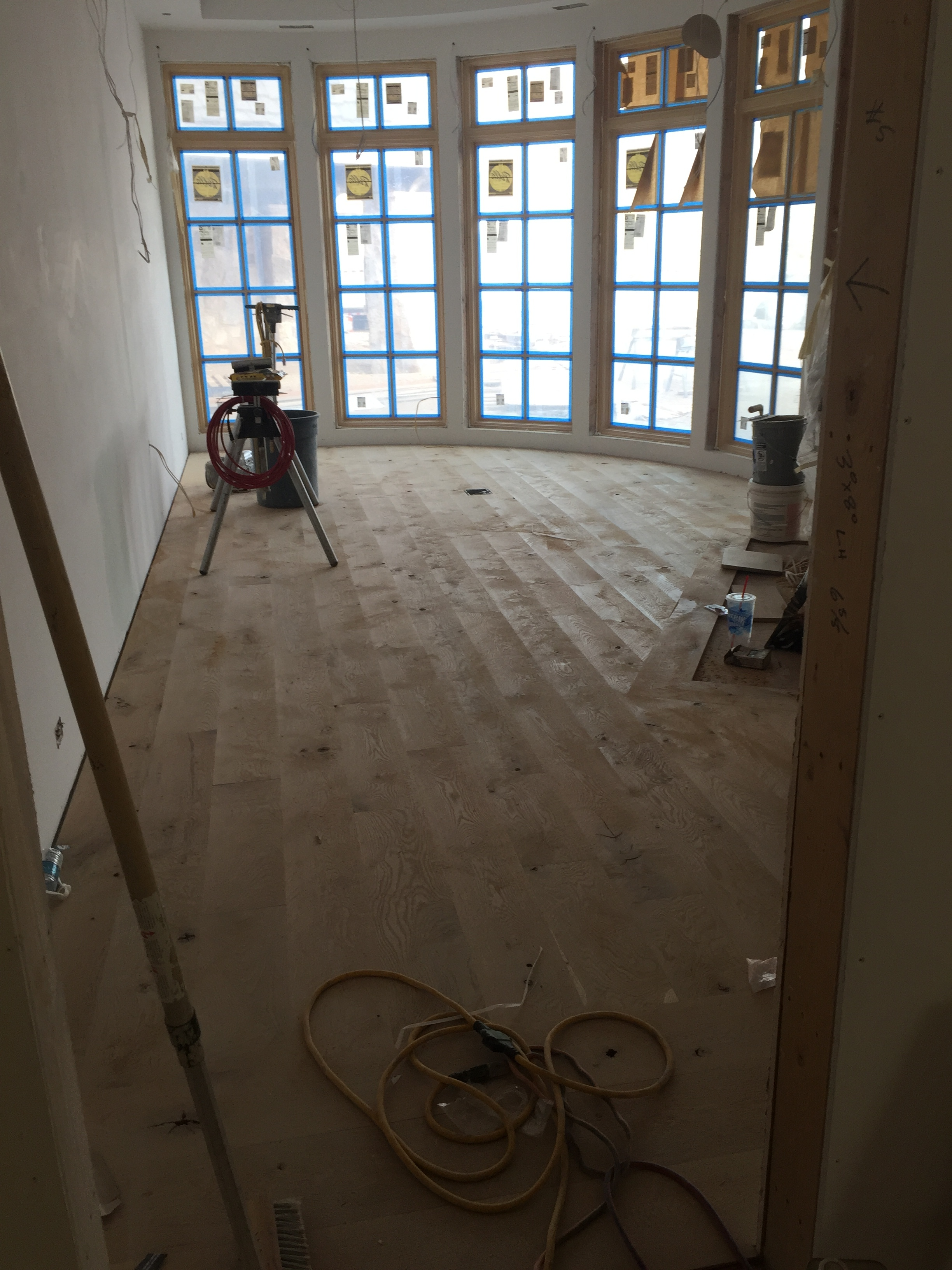 We decided on French Oak wood flooring for the office found near the front of the house. Another wall of amazing windows will make for bright space!