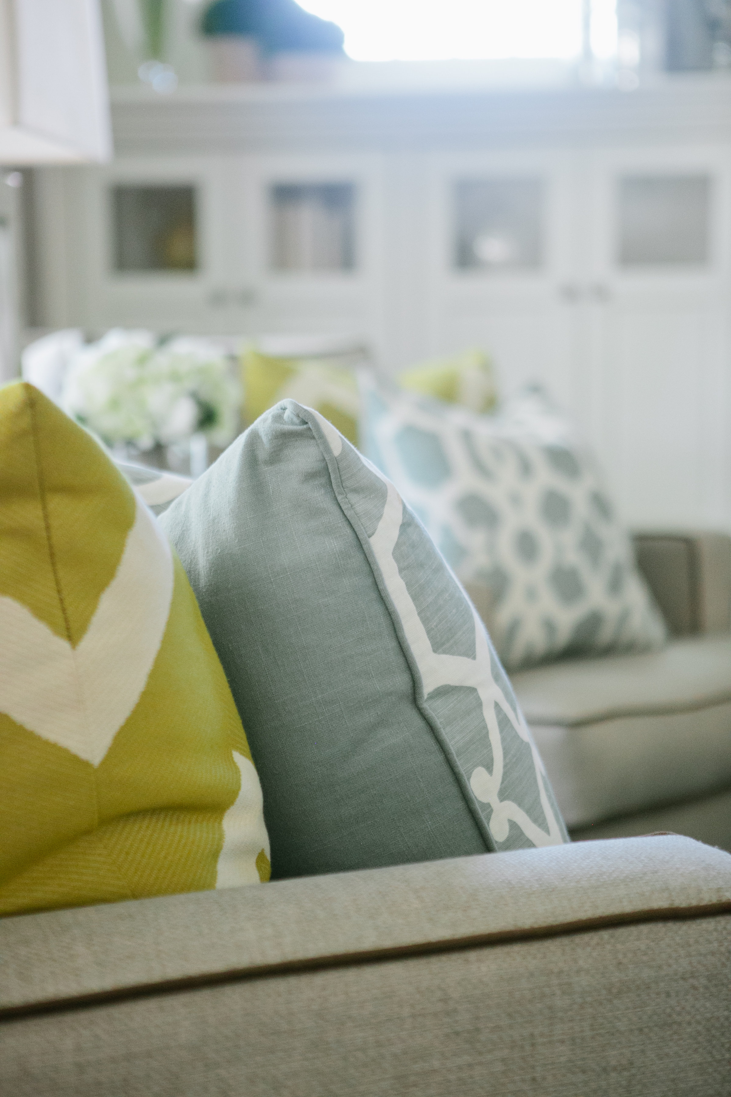 Pillows are another totally useful accessory that can brighten any space. We love coming up with various color combinations.
