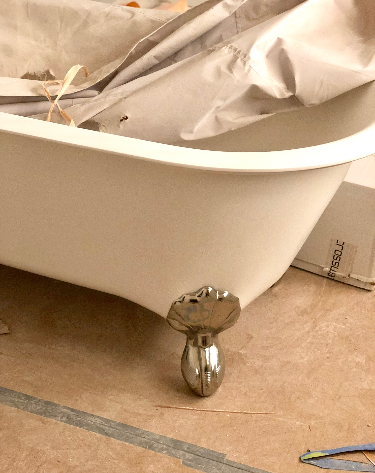 "This silver claw-footed bathtub in traditional white porcelain is so whimsical and just perfect for the young girl's bathroom it will be going in. The ""feet"" may just be our favorite detail of all these gorgeous tubs!"