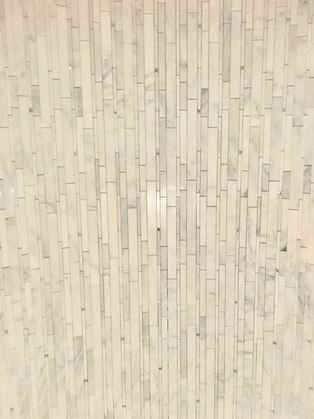 Another sneak peak of some tile going in, this is found in the shower of the same sweet girl's room. The tile is white and bright with subtle sparkles all around. This picture (which was taken in the dark!) does not do it justice!