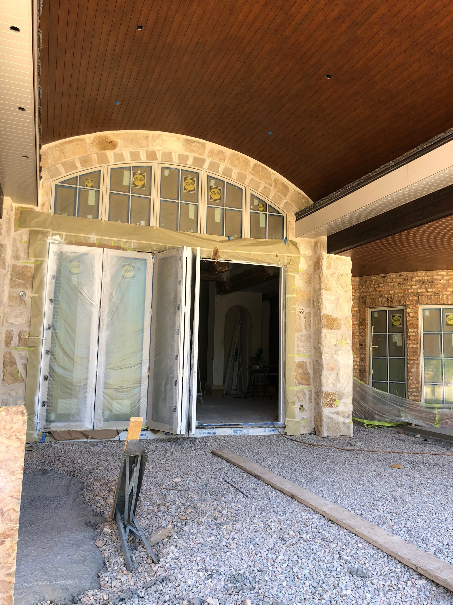 Finally, a shot of the back of the house! This folding door is accessed through the home's main living area and leads out to what will eventually be the backyard and patio.