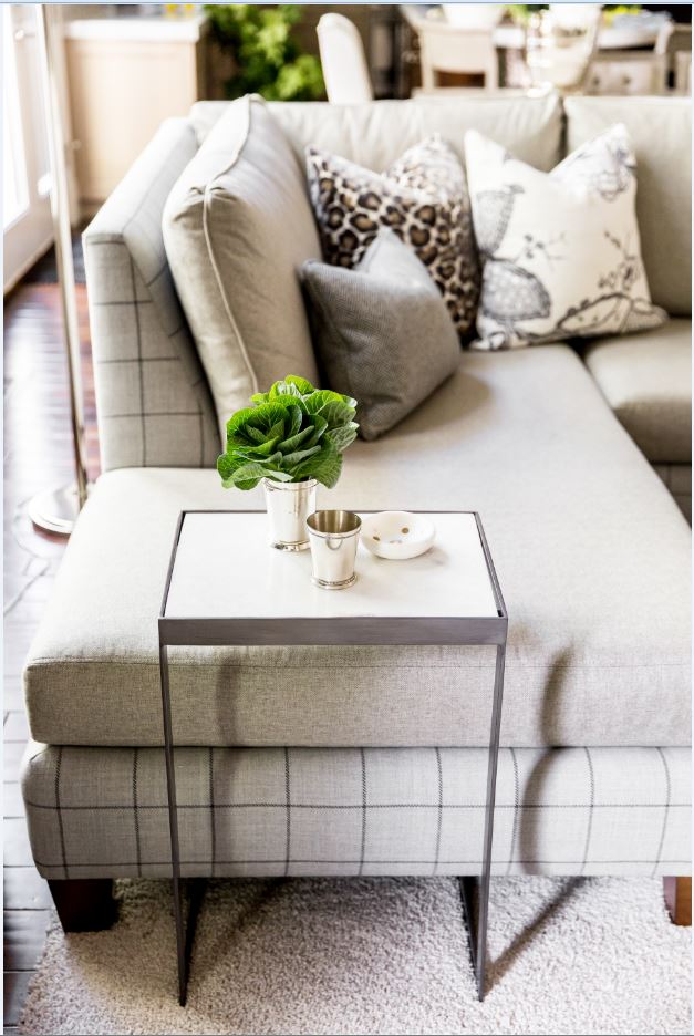 The custom sectionals are so unique and this pattern combo really has our hearts. And this side table is the perfect functional addition.