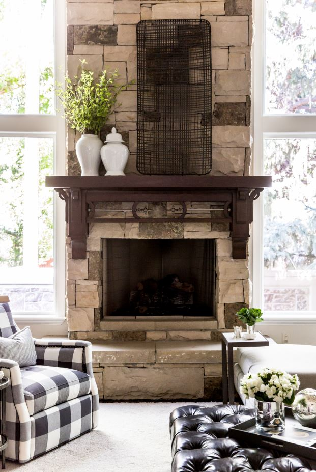 And finally, here's a look at the fireplace and mantle. Because it is so gorgeous on its own, we decided to go simple on the accessories here and add just a few jars with greenery and the oversized metal art. It turned out perfect!  In the next few weeks we'll share more rooms from this amazing home, so stay tuned!