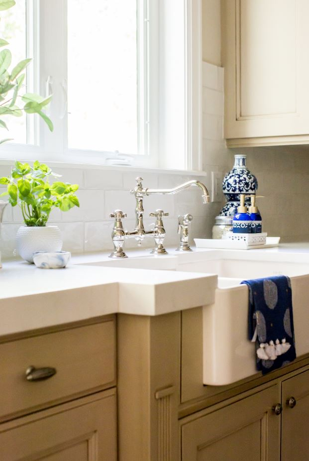 This close-up of the apron sink is all about the faucet! While the sink is amazing, the faucet is absolutely gorgeous. It is so unique and really is the perfect piece for this fabulous kitchen.