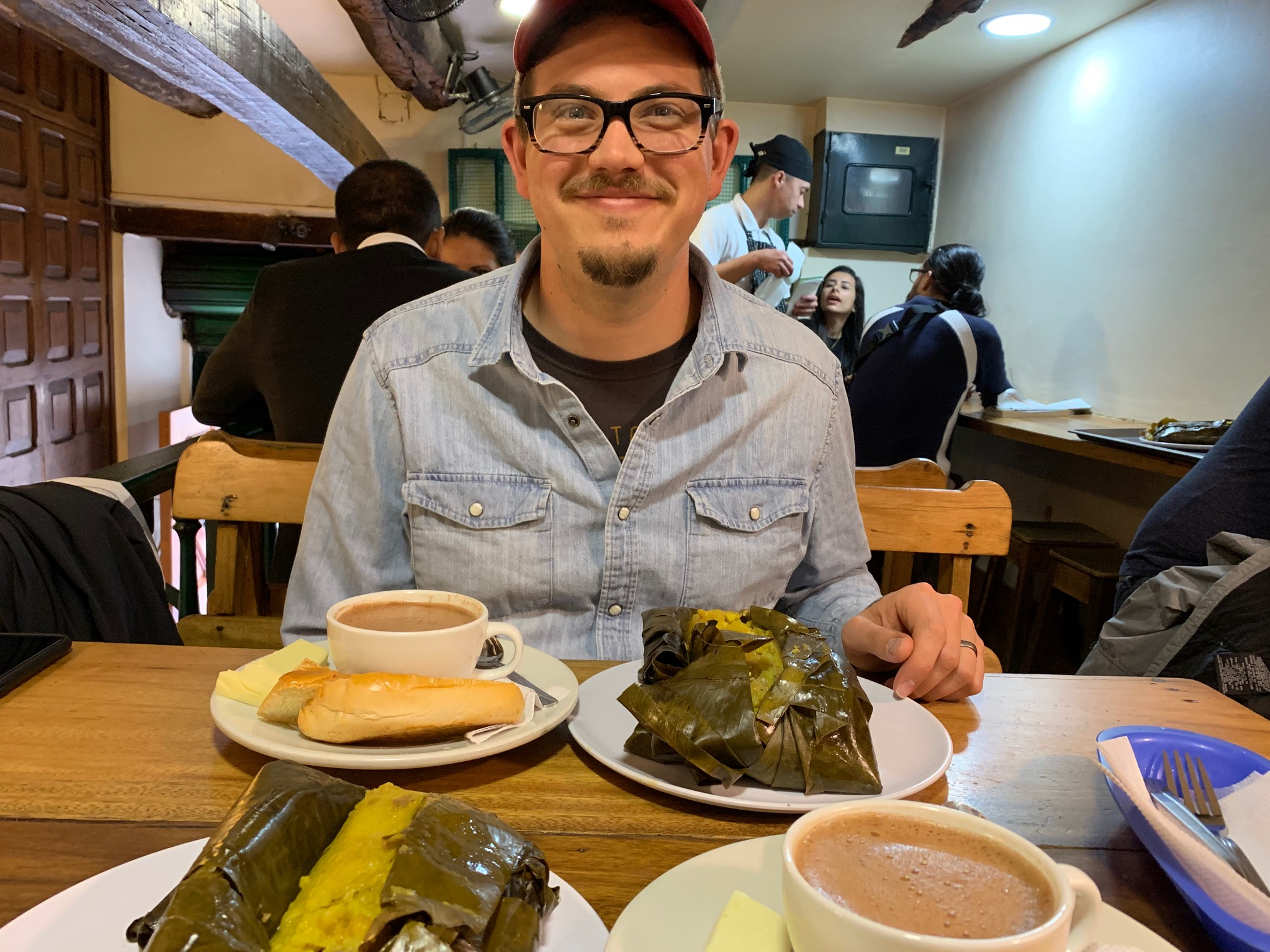 Justin very ready to dig into his giant tamal and wishing for me to stop taking photos already.