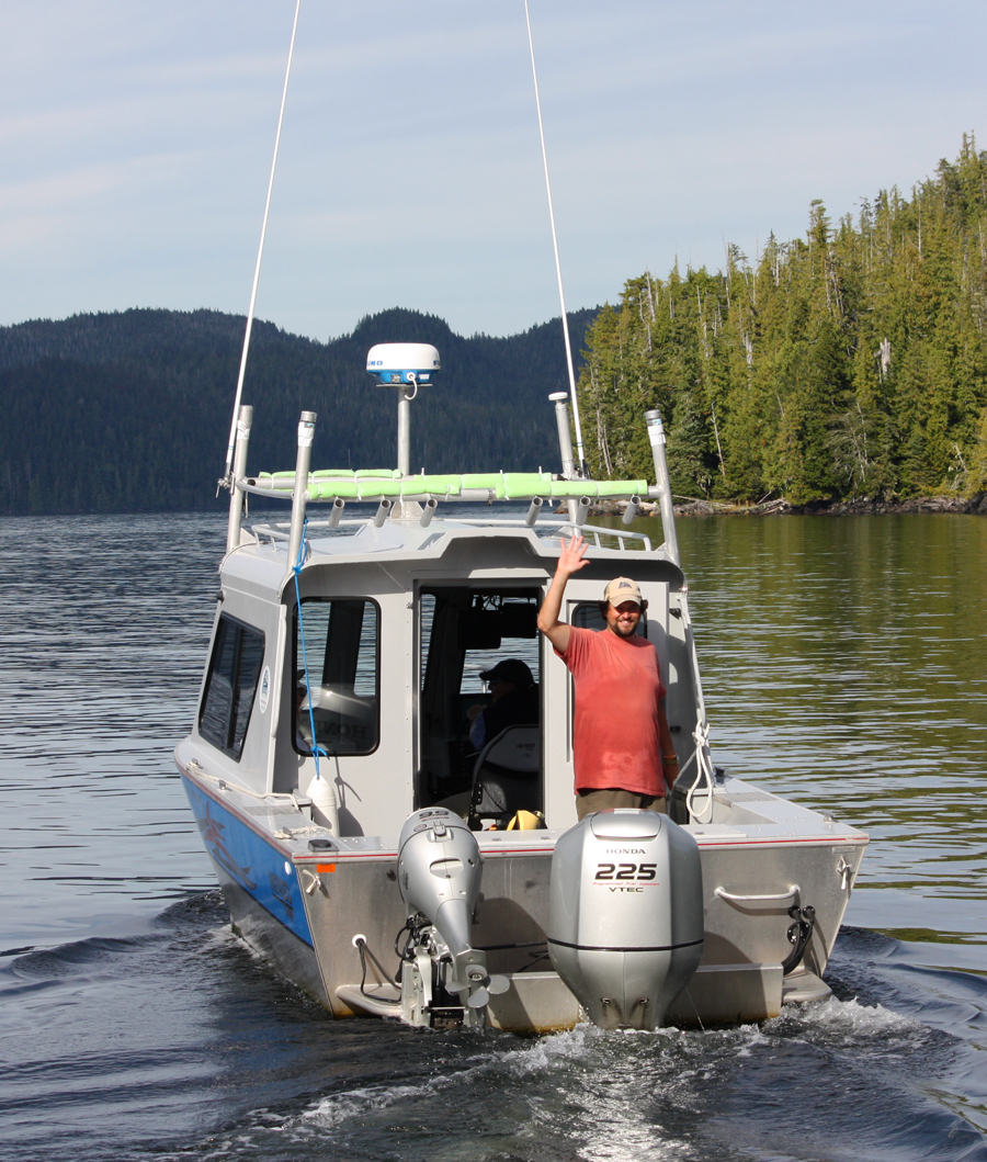 Guides deckhand on the boat to Orcas Cove
