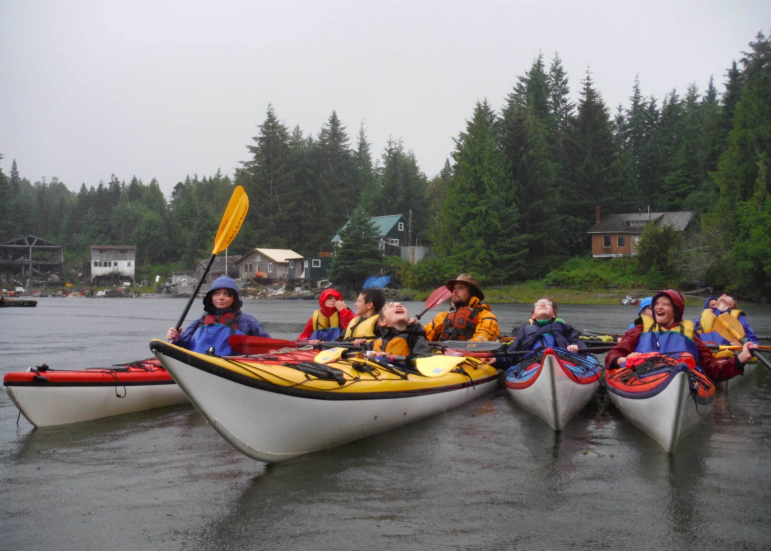 Torrential rain never stops Ketchikan Kids from having fun! Kids with instructor, James White.