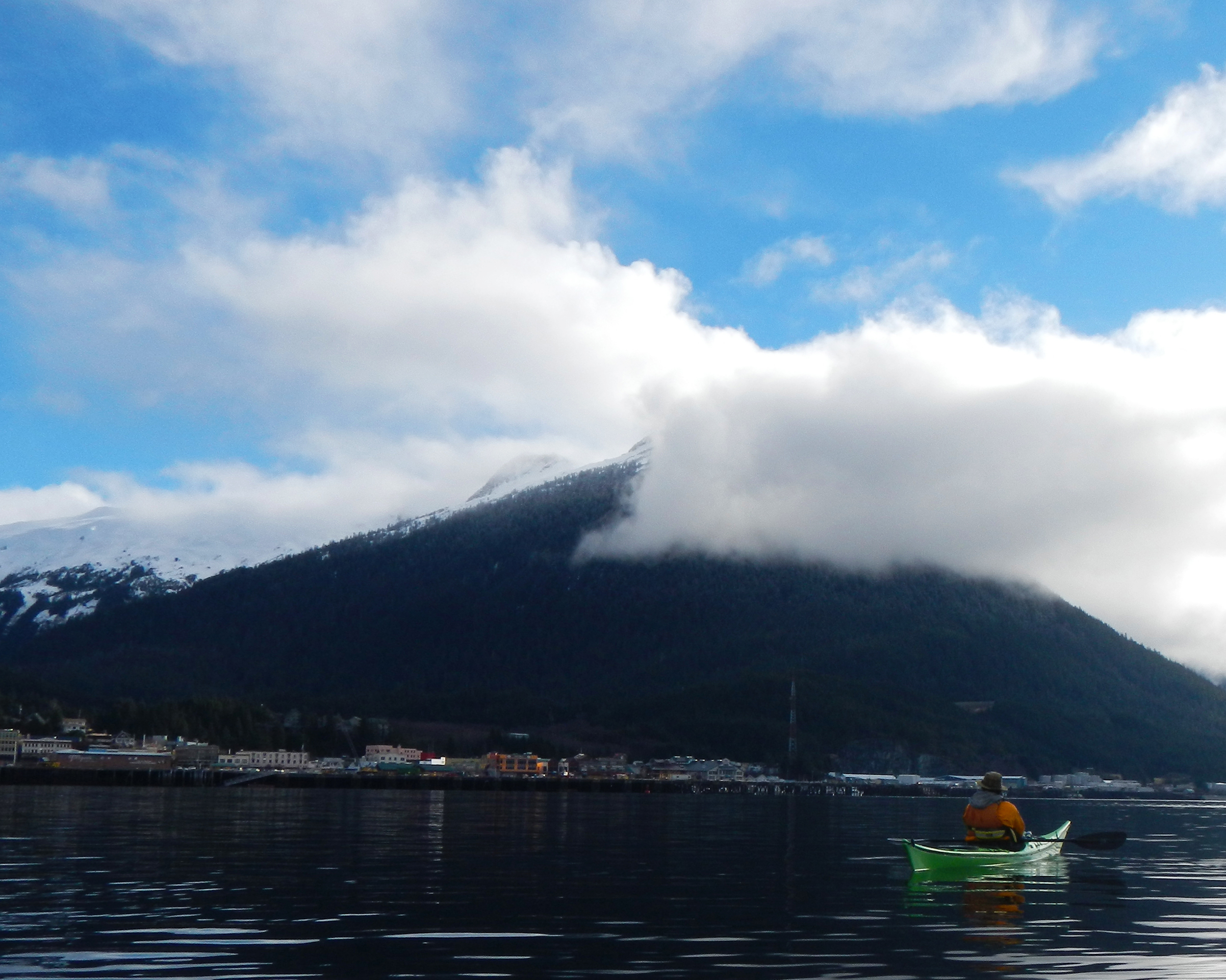 The town of Ketchikan, with Deer Mountain above and James in his kayak.