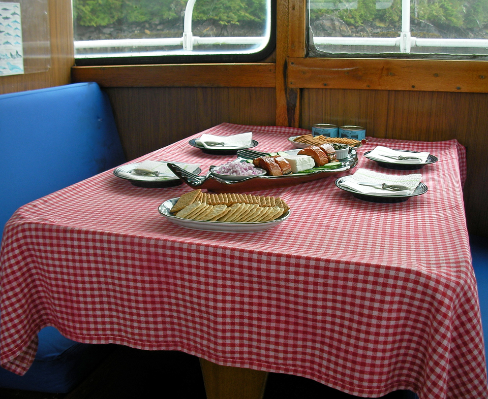 Wild Alaskan smoked silver salmon on board the mothership Sea Spree is a welcome treat for hungry kayakers.
