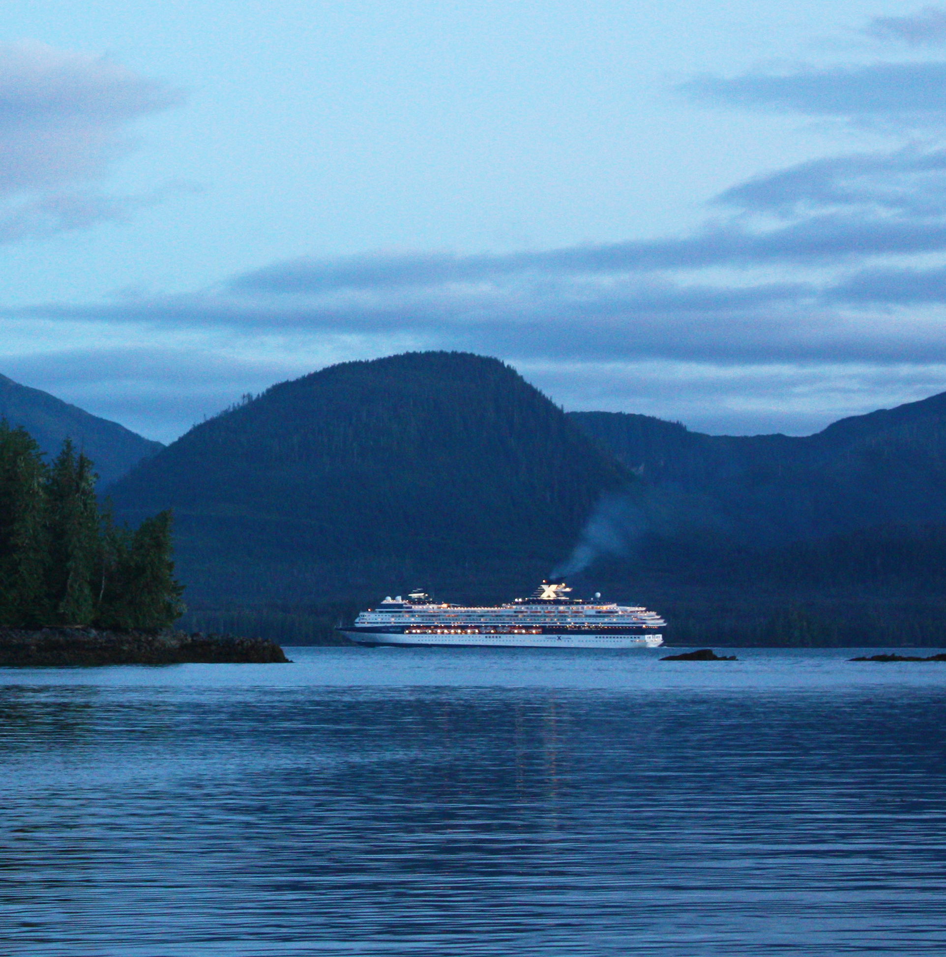 Celebrity cruise ship headed south along the Inside Passage from Ketchikan, Alaska.