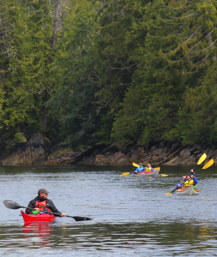 Kayakers heading out of the Salmon Stream at Orcas Cove