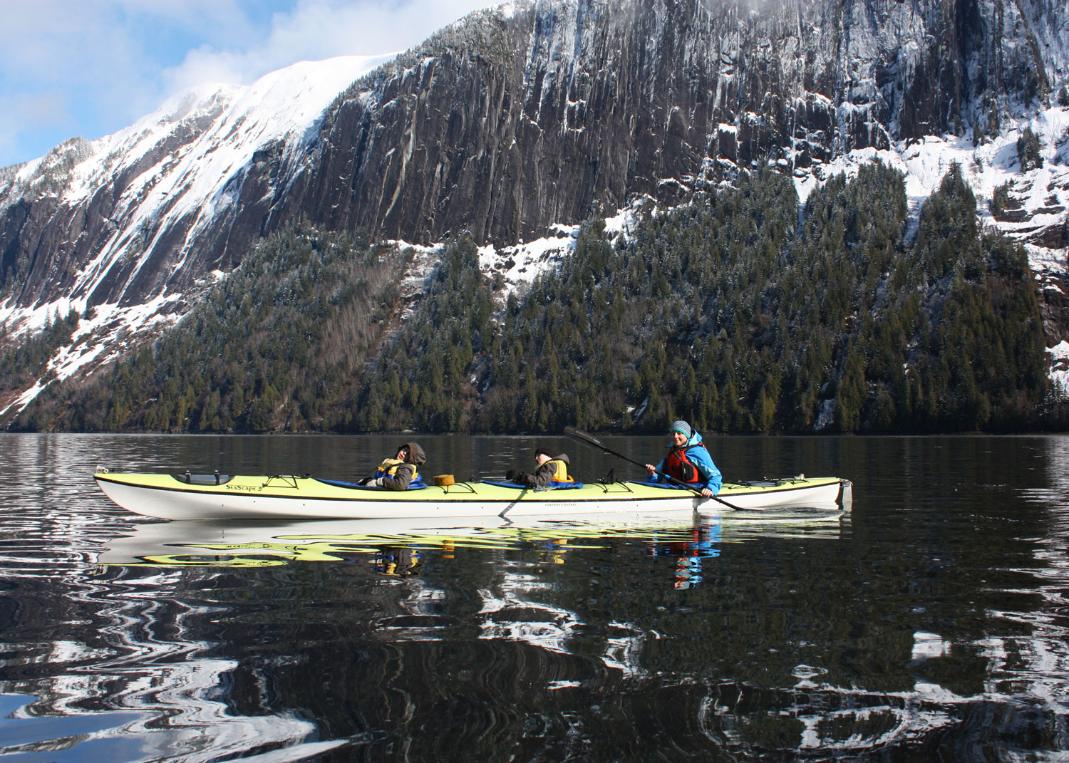 Spring break kayaking in Misty Fjords National Monument. Triple kayaks are great for families. Northwest Kayaks' Seascape 3 is our favorite; it has a huge rudder and is very easy to paddle even with 2 kids in the front.