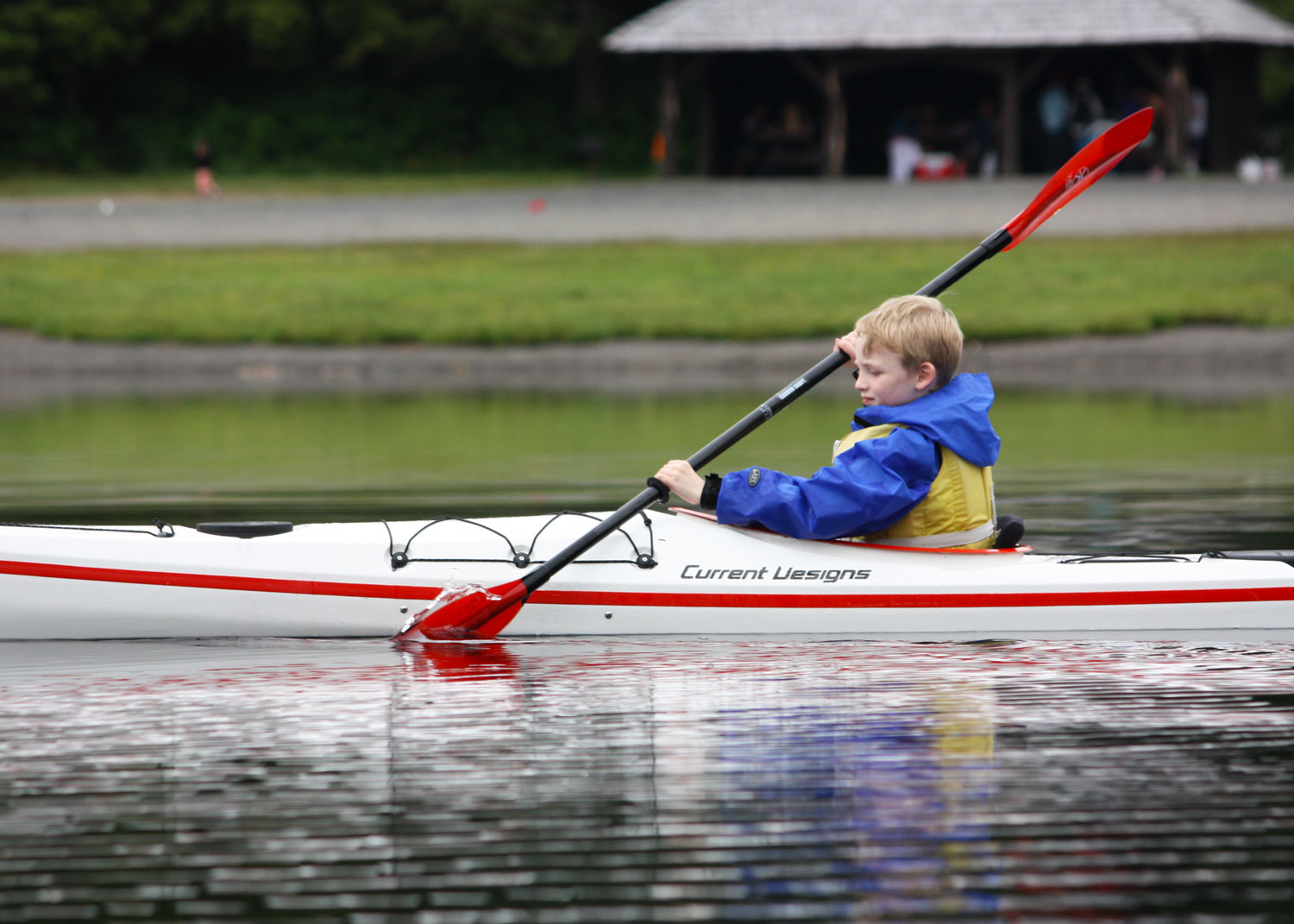 7 years old: kayaking on Ward Lake in Current Designs' Raven kids kayak.