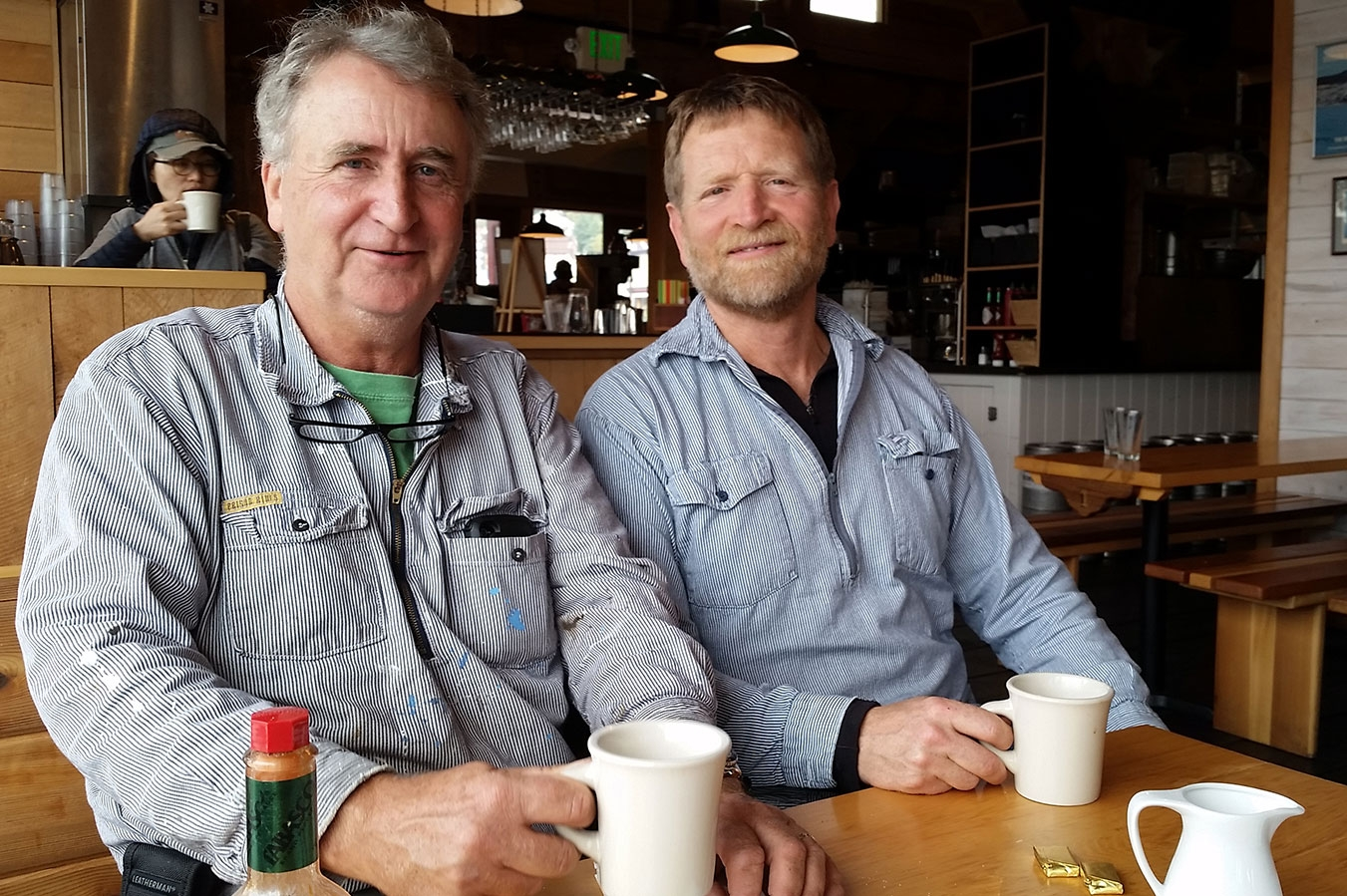 Southeast Sea Kayaks' Owner Greg Thomas shares a cup of coffee with Chuck Slagle at Chuck's restaurant, The Alaska Fish House.