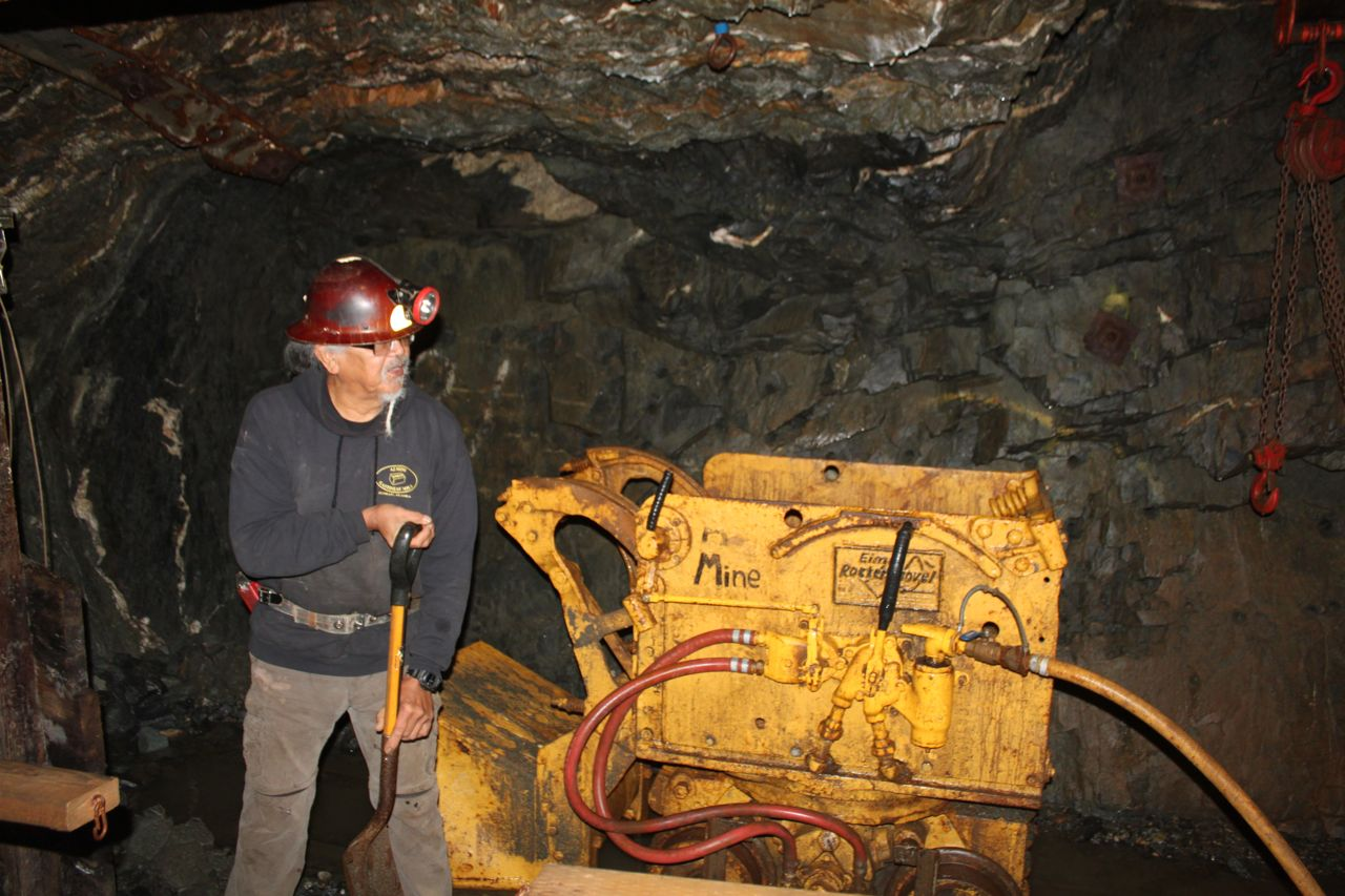 Bob, the miner, explains a pneumatic shovel at the Gastineau Mine Tour.