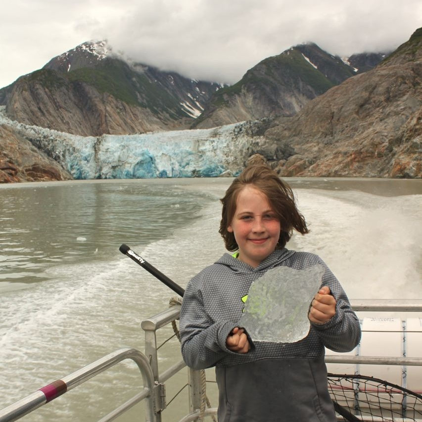 Declan holds a chunk of glacier on the Tracy Arm Boat Tour.