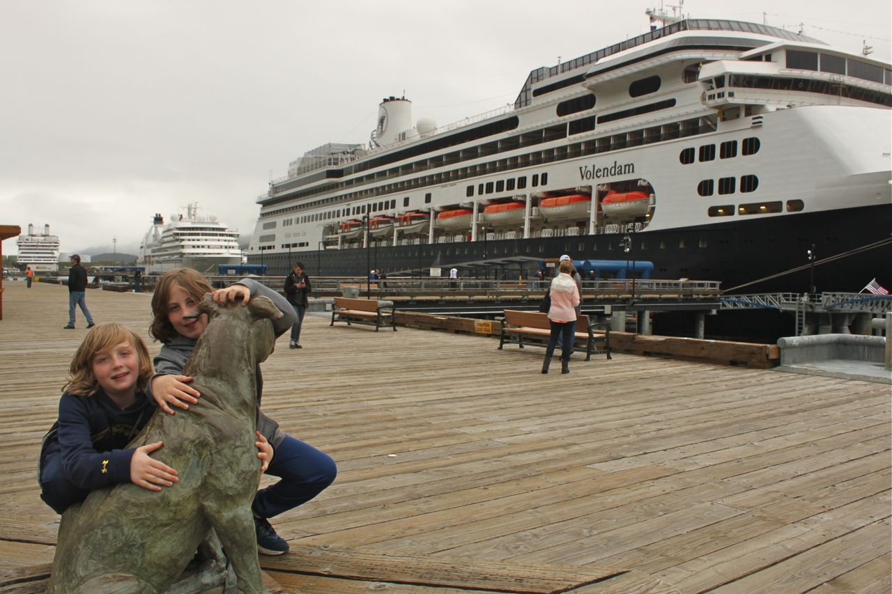 Clancy and Declan with the Patsy Anne statue on the cruise ship dock in Juneau, Alaska