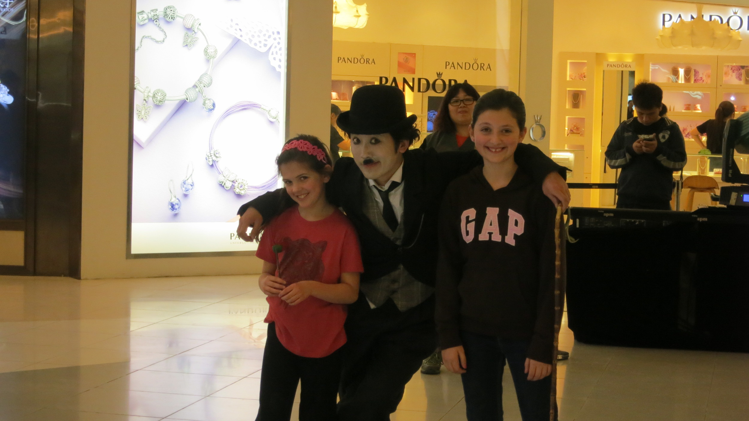 Abigail and her new buddy Isabella danced with Charlie Chapman in the mall!