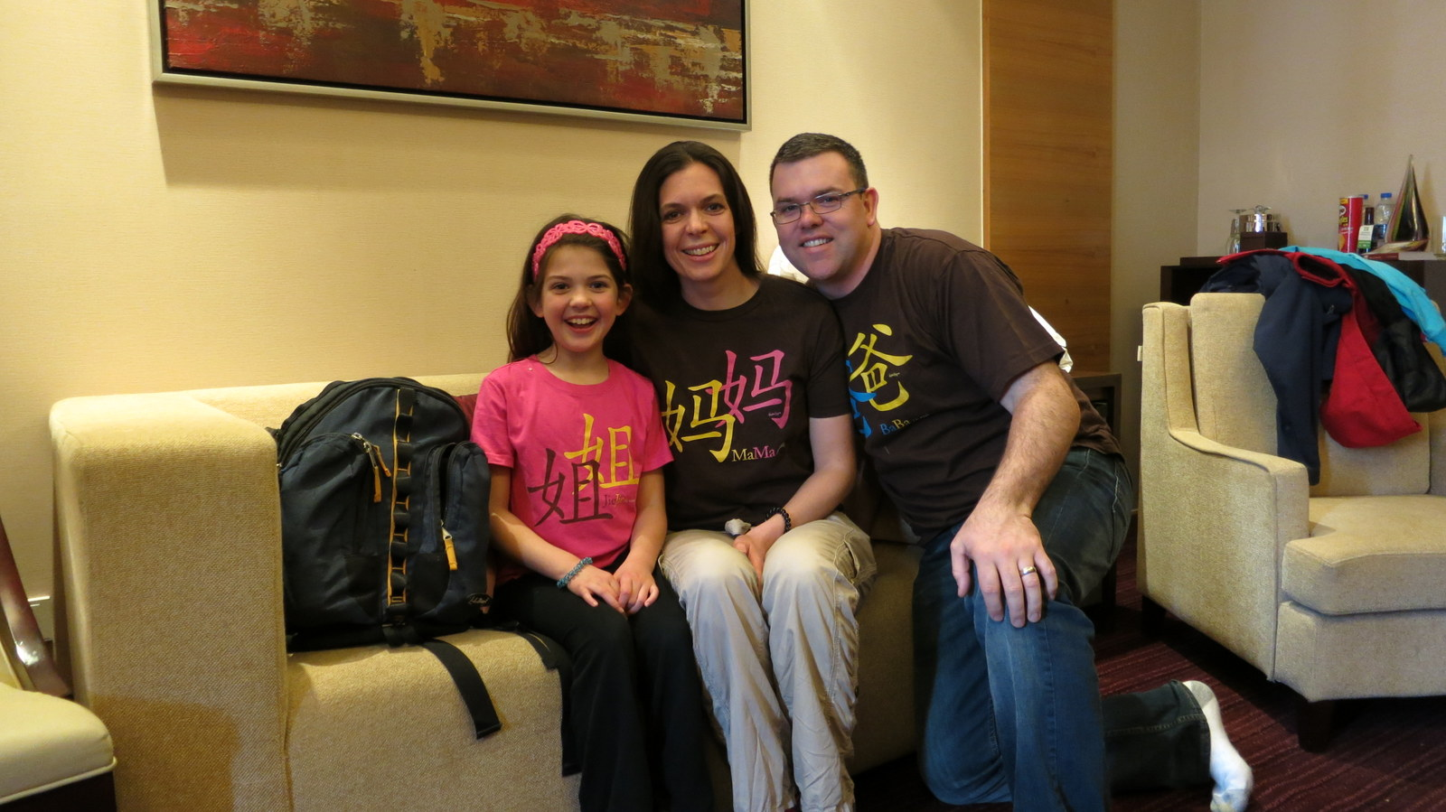 Wearing our t-shirts that say Mommy, Daddy, and Big sister in Chinese.