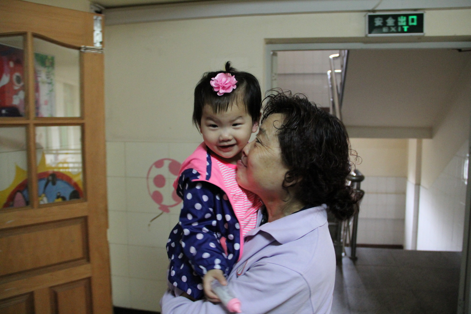 A sweet moment with her nanny.
