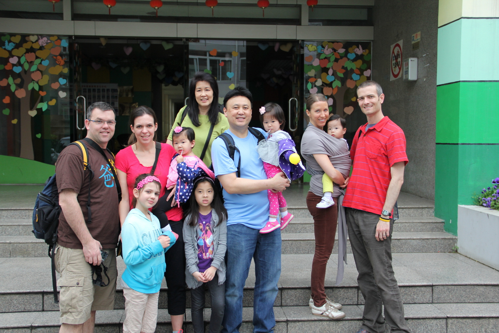 Our travel group outside the orphanage. All our girls were in there together.