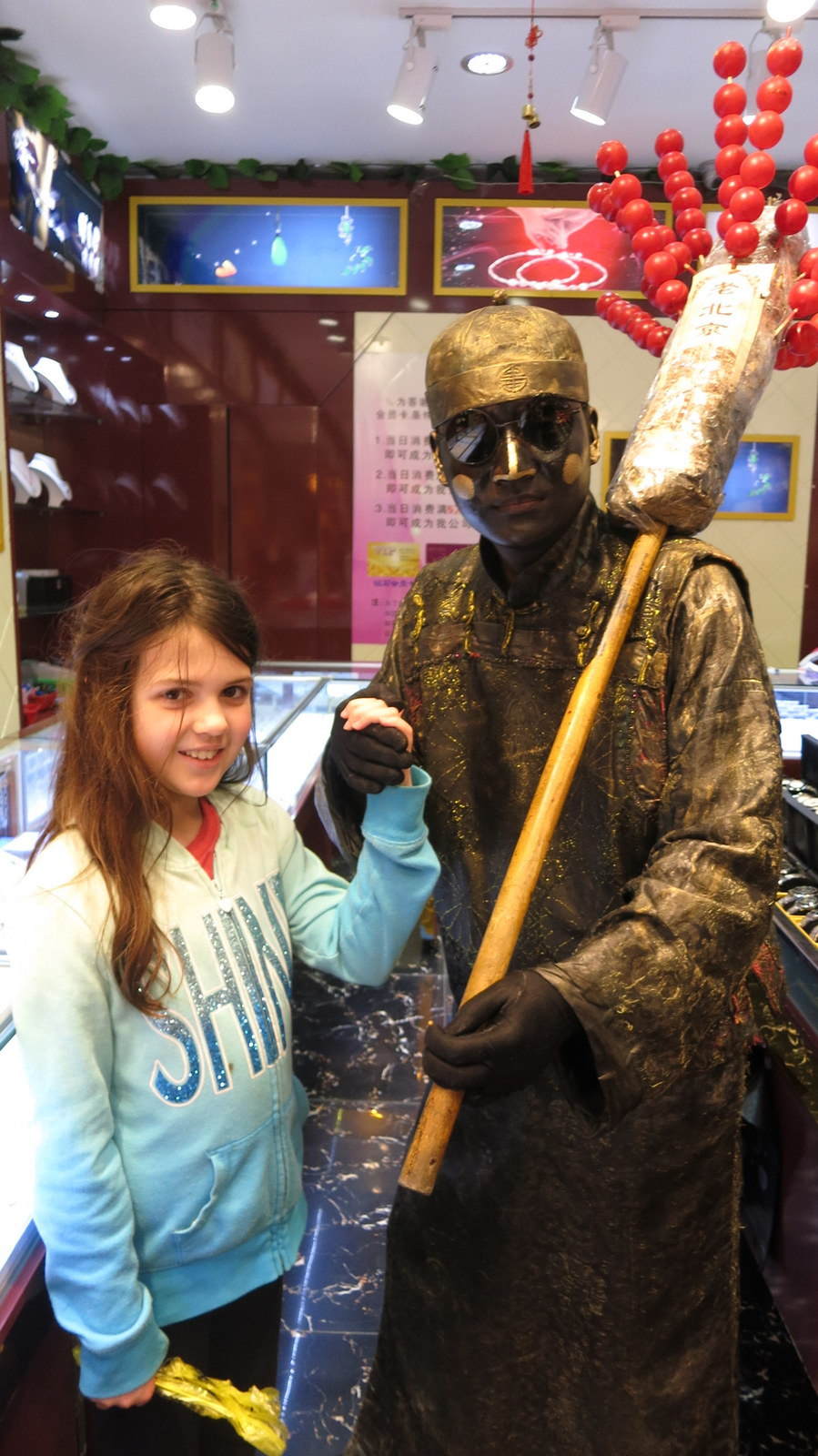The freak statue man that stalked Abigail through the store.