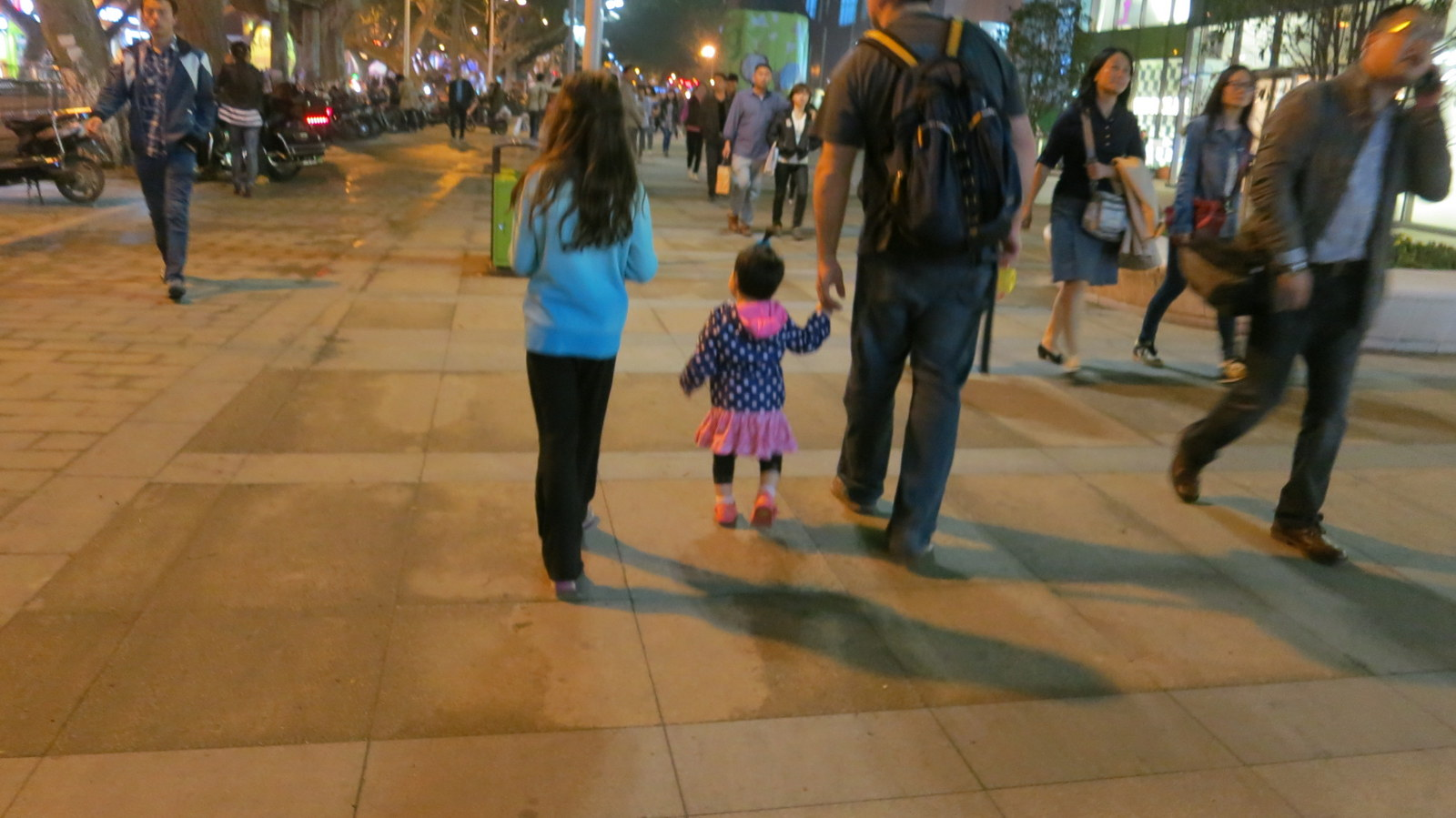 Yesterday she would not walk anywhere unless attached to my finger. Tonight, she's a daddy's girl. Beautiful!