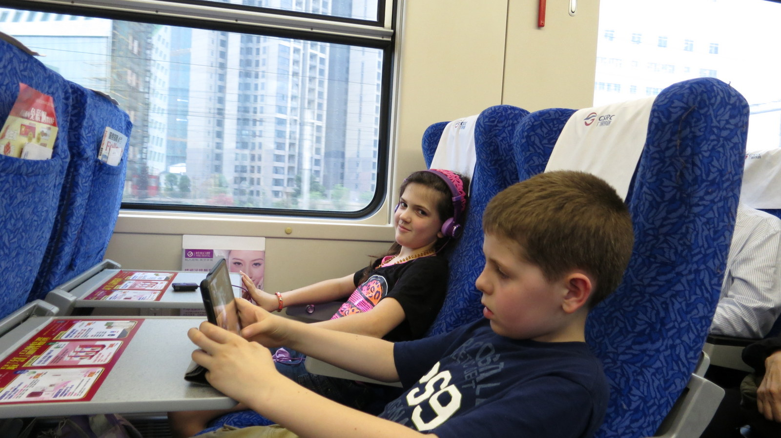 Abby and our Jersey friend Aiden on the train to Hong Kong.
