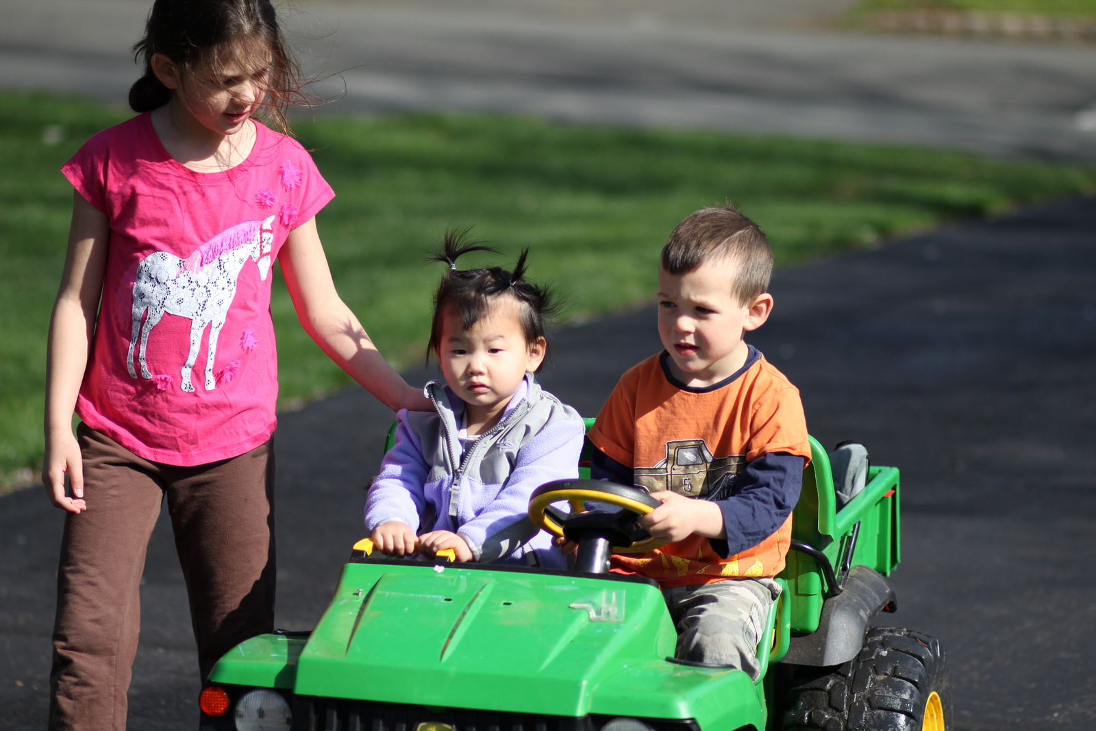 She loves riding in the gator with her brothers!