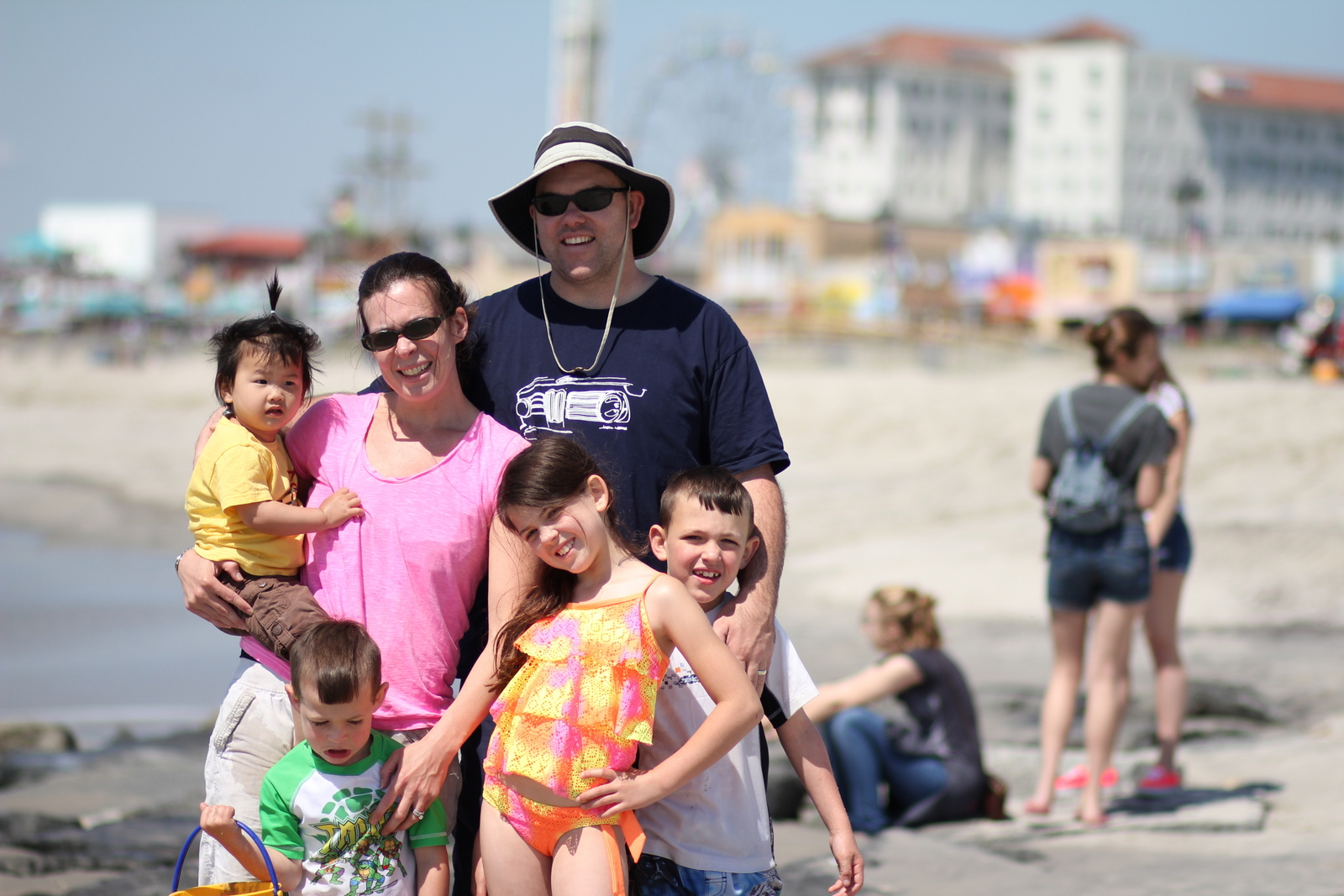 My happy family of 6!  Oh wait, not Trevin, he's mad we took him away from his sand castle.