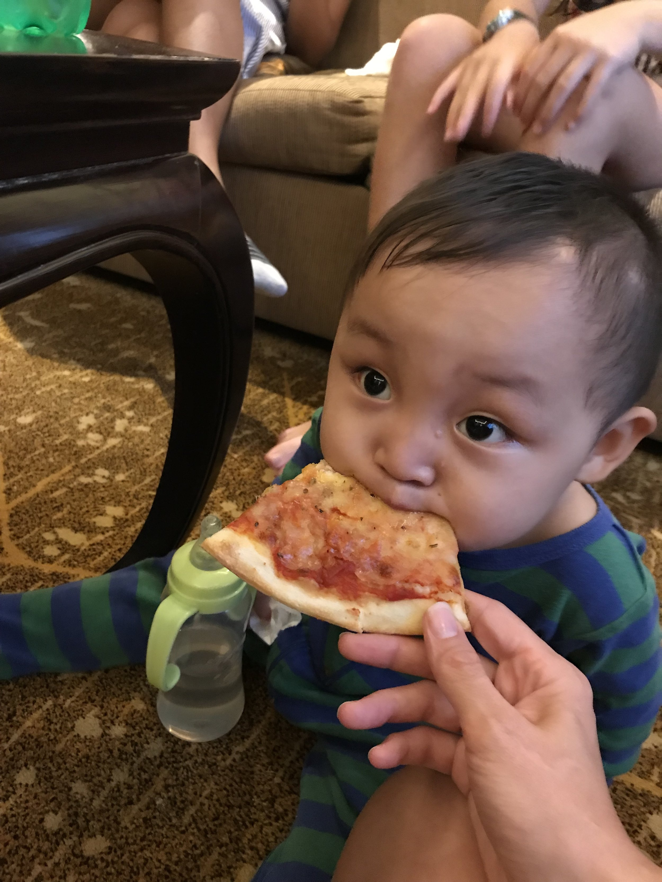 This boy loves pizza!