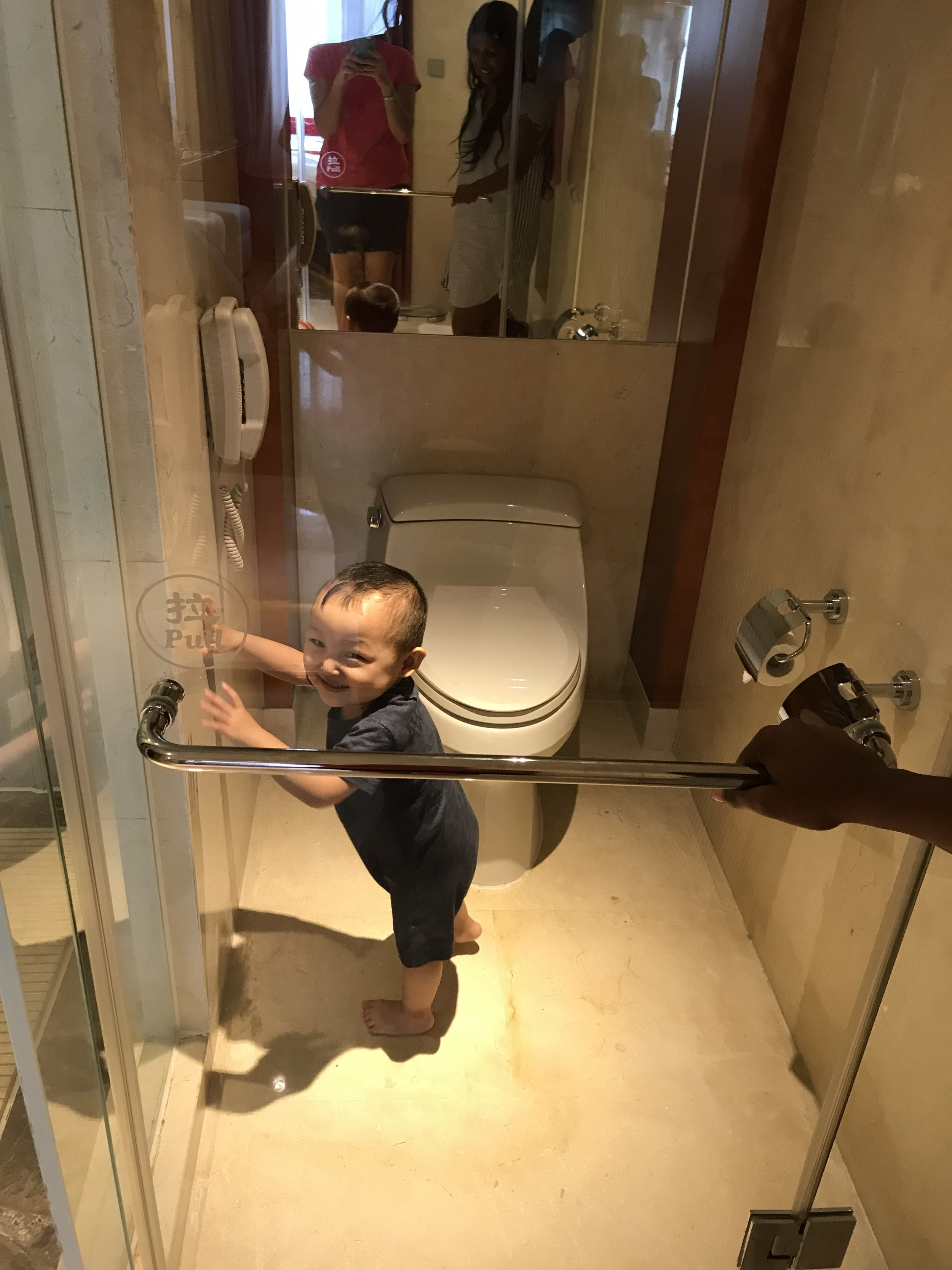 Why bother putting a GLASS door on the bathroom? Luke likes to mess with the toilet. Yeah!