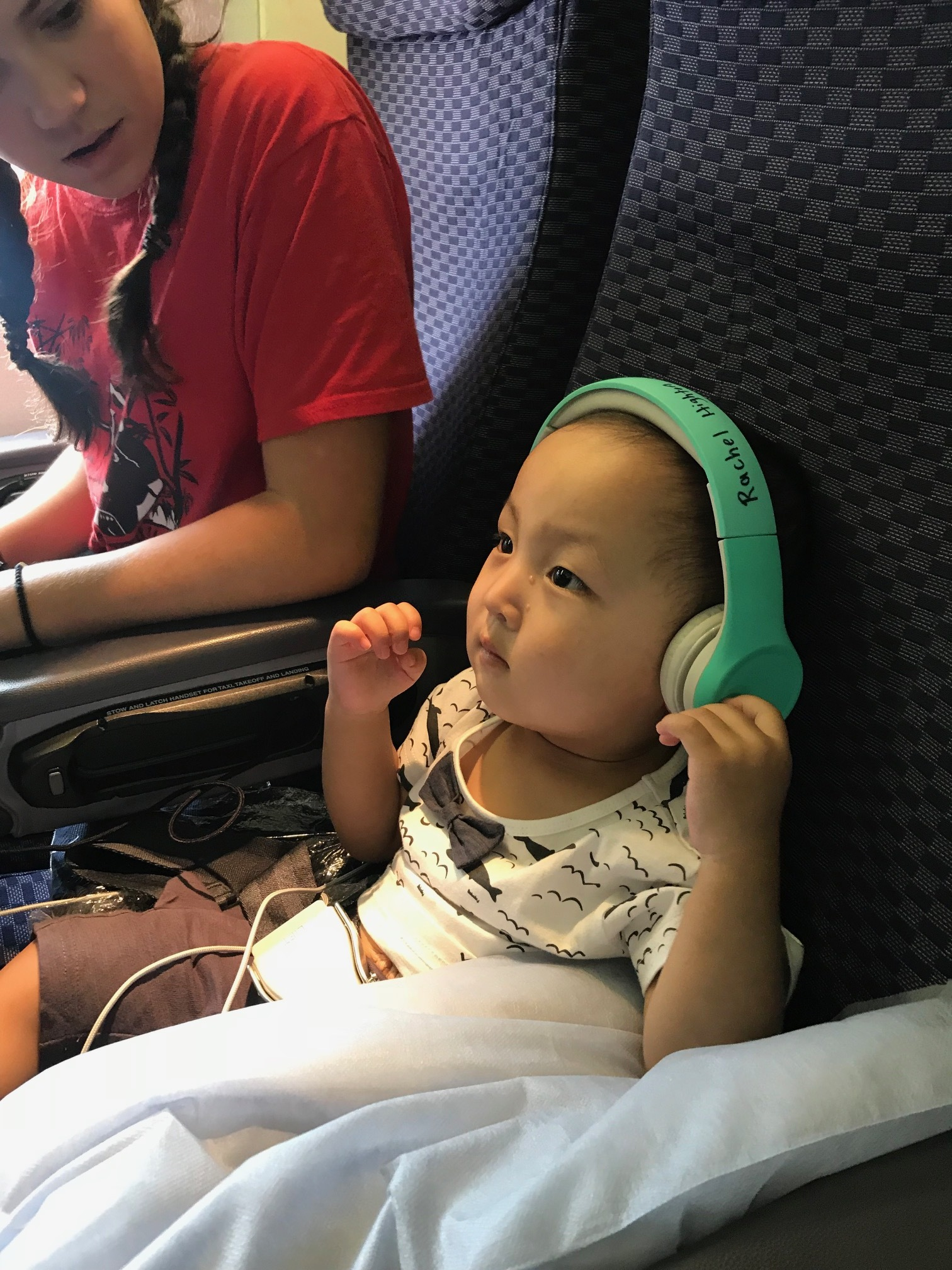 He kept these on less than 30 seconds... I was really hoping he would become a movie junkie on the plane.