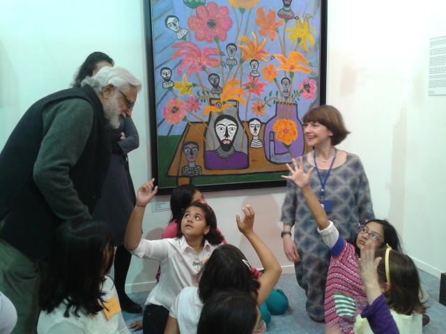 Artist Manu Parekh interacting with children