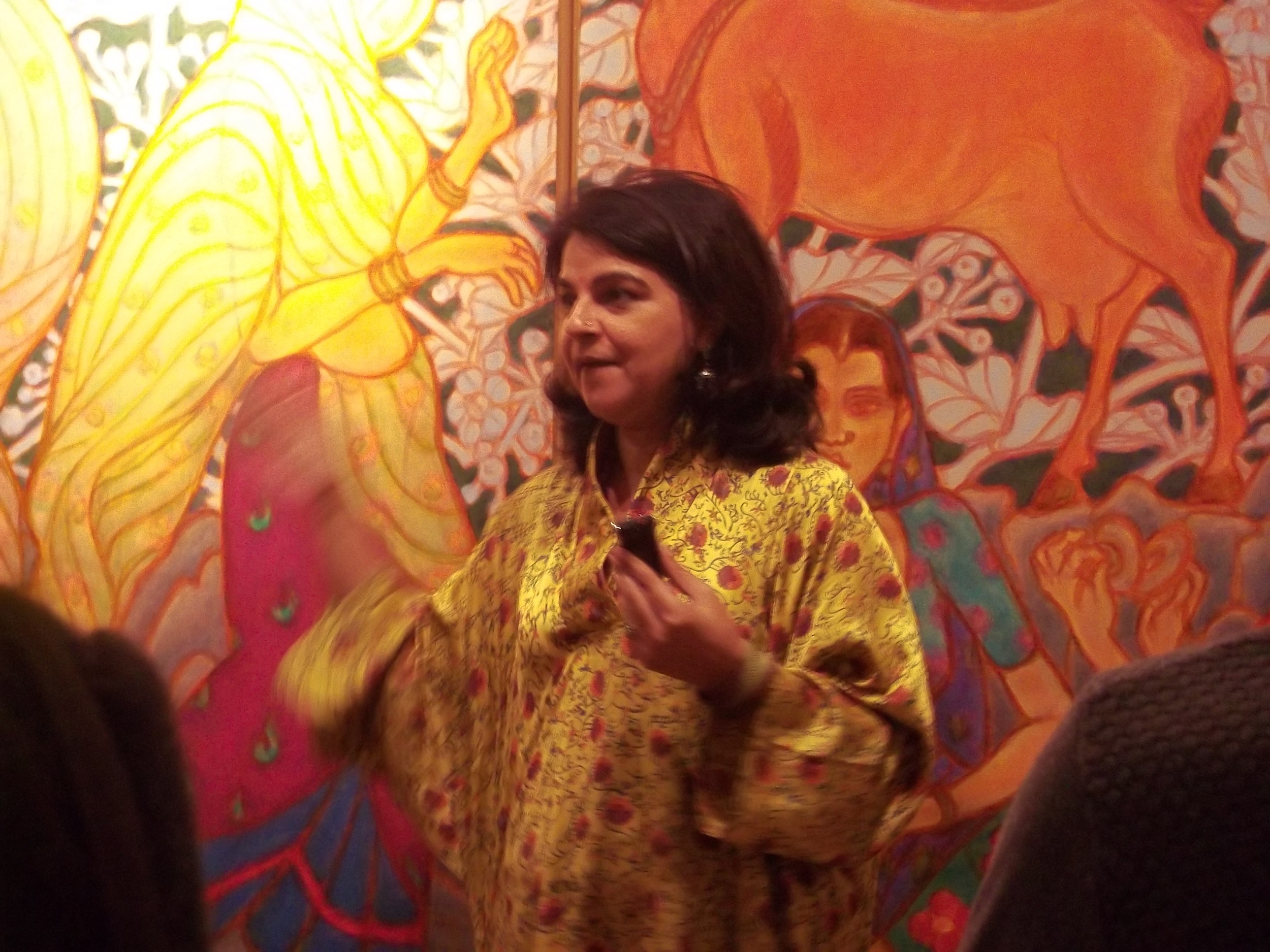 Manisha Gera Baswani taking the group on a walk through of Ramachandran's exhibition at LKA