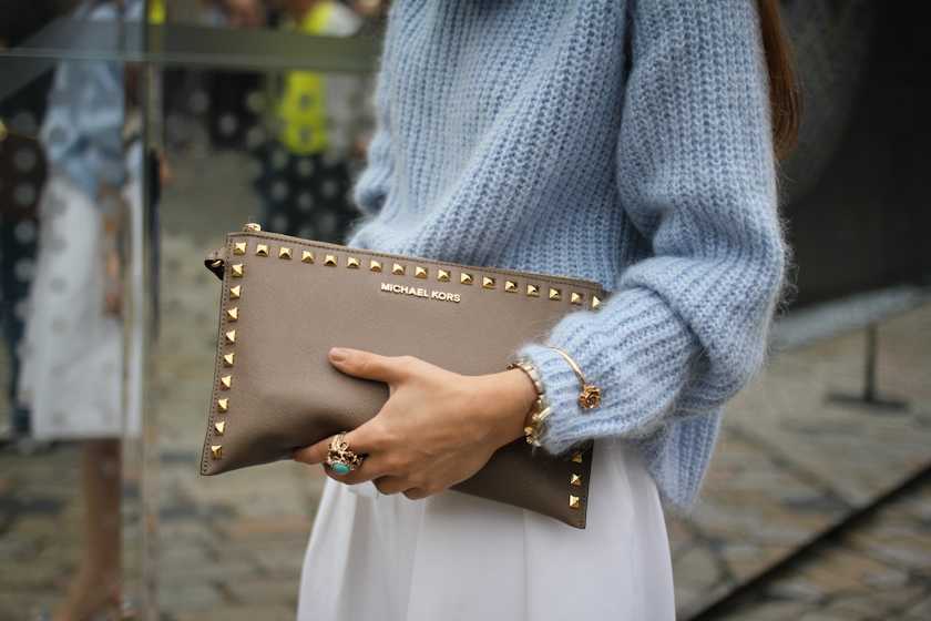 Fluffy sweater and Michael Kors clutch at London Fashion Week