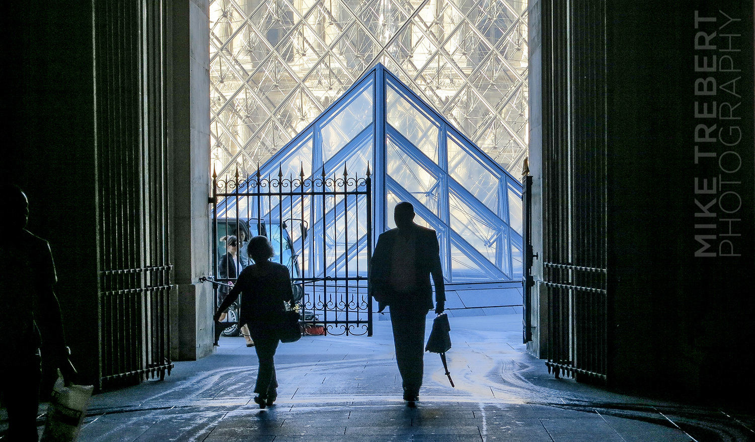 Early morning Paris. Heading through an entrance to The Louvre